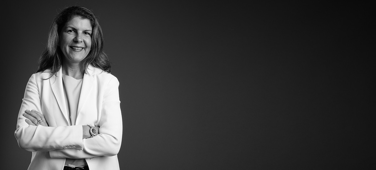 Studio shot of mature businesswoman wearing pant suit against gray background horizontal shot